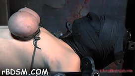 Restrained cutie is made to suffer underneath hard toy playing