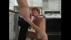 y. guy gets blown by 70 year old redhead in kitchen