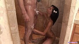 Alluring asian teen massaging her client