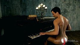 Hot young man with erect dick and nice butt strips naked playing the piano