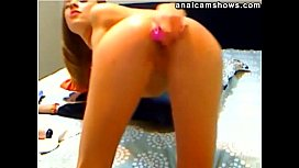 Teen fucking her ass with red dildo