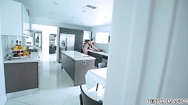 Stepson gets an eyeful as stepmom stands at the sink!