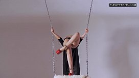Professional gymnast from Russia doing gymnastic exercises in front of the camera.