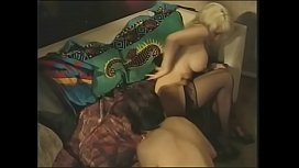 Sexy blonde Ashley Taylor with big tits is fucked by hippy dude'_s big cock on couch