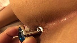 Playing with Anal plug on my girlfriend's ass