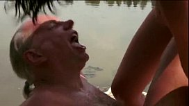 Dolly Diore has a golden shower with an old man by the lake
