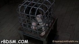 Caged up cutie needs torment