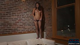 Two gorgeous brunette models stripteasing and posing