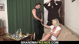 Horny blonde lady swallows two cocks at once