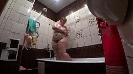 Lesbian has installed a hidden camera in the bathroom at his girlfriend. Peeping behind a bbw with a big ass in the shower. Voyeur.