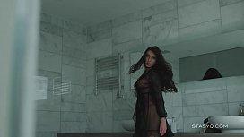 Busty russian babe Megan teasing from the bathtub