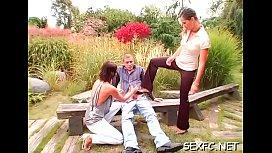 Females share the same shlong in superb back yard clothed porn