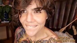 Hot tattooed brunette deepthroats and fucks dildo with plug in ass
