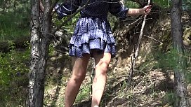 Under a skirt without panties. Hairy pussy and big ass in a short dress climbs mountains in nature.