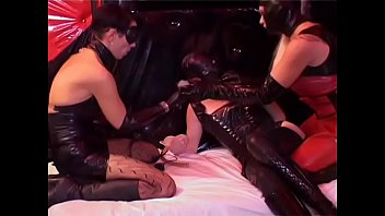 Cute Filn-Coated Babe Gets Her Pussy Fucked By Couple Of Strict Mistresses In Black