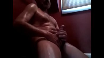 Stroking my cock and cumming.