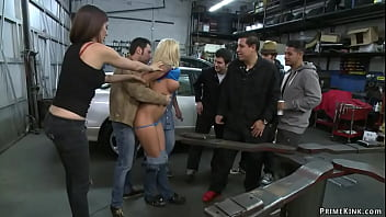 Bound blonde fucked in car body shop