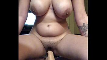 Latina girl bouncing and cumming on 10 inch dildo
