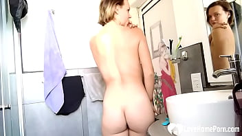 Fit beauty teases while washing her teeth