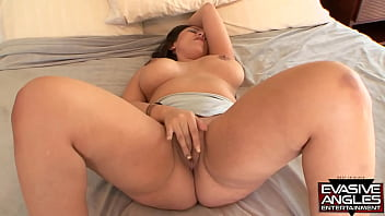 EVASIVE ANGLES All natural boobed brunette MILF performs a solo masturbation, rubbing her clitoris and fingering her shaved snatch for an orgasm