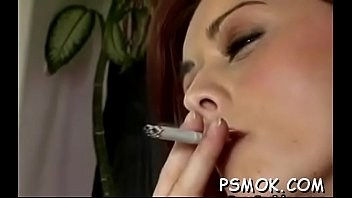 Hotty enjoys a cigarette while putting a dick in her mouth