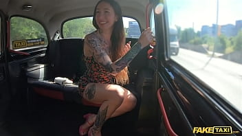 Fake Taxi Tattooed babe seduces the taxi driver by showing off her tattooed body