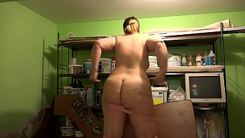 A bbw with a big ass in the pantry finds a bottle and masturbates with her. Oily hairy pussy gets pleasure.