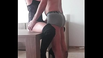 Hot milf in boots gets fucked on table