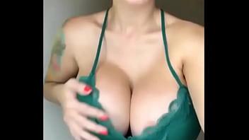 sexy busty beautiful woman in dress