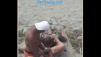 Nude beach threesome - Threesome in the sand caught