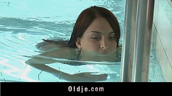 Sweet redhead teen sucking old cock at the pool