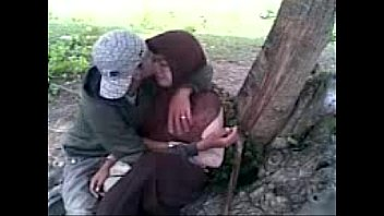 Girls in Hijabs Enjoy Kissing in the Park.FLV