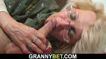 Shaved-pussy mature woman