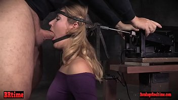 Drool covered bdsm babe sucking dicks