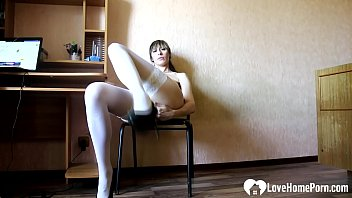 Hot secretary in white stockings masturbates passionately