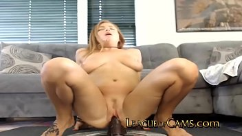 Housewife rides giant dildo in living room