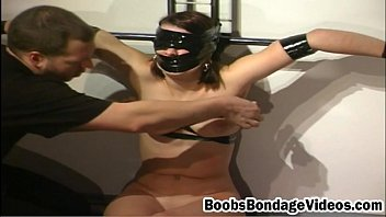Brunette in latex gets tied and t. with clamps and other toys