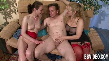 Threesome woman German woman sharing cock with a mature bitch