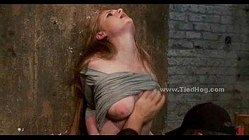 Blonde immobilized on bondage device