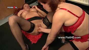 Two red haired horny MILFs love fisting