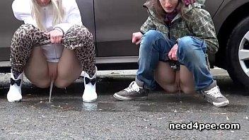 Behind peeing - Teen girlfriends pissing behind a parked car