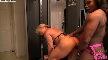 Women with sex toy Two female bodybuilders fuck with a strap on dildo