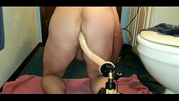 Long dong leo dildo on a fucking machine