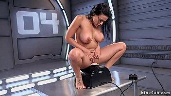 Huge tits dark haired babe fucks machine