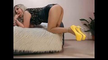 Hot MILF in leather striptease