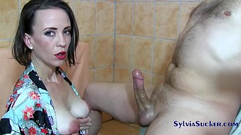 Sylvia filmed rubbing her cock and being sprayed with cum between her breasts