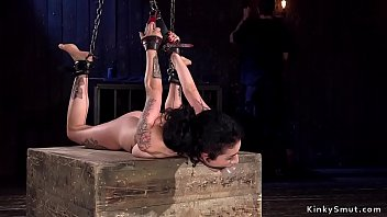 Brunette in chains gagged with dildo