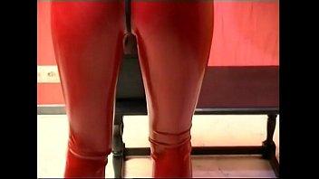 Tied up slave girl posing in latex
