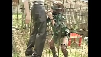 Sexy slave in cage has a hard lesson