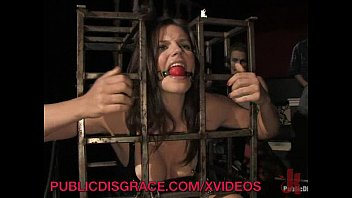 Public Party Plays with Caged Slave